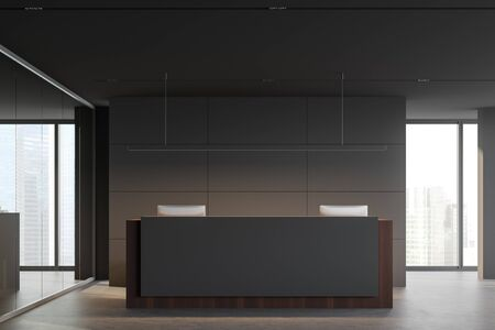 Front view of minimalistic corporate office with gray walls, concrete floor, comfortable grey and wooden reception desk with two computers and windows with blurry cityscape. 3d rendering
