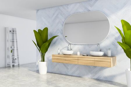 Corner of stylish bathroom with blue wooden and white walls, concrete floor, double round sink with oval mirror standing on wooden cabinet and shelf with beauty products. 3d rendering