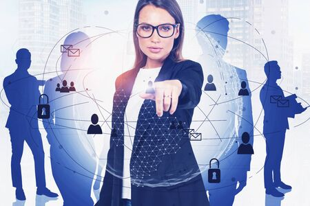 Beautiful young European businesswoman in glasses working with creative social network interface in blurry city with business people in background. Concept of HR. Toned image double exposure