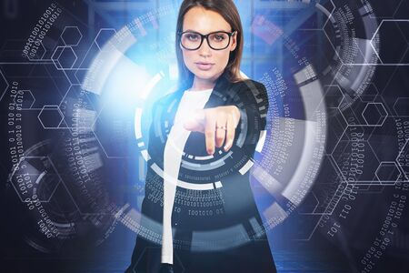 Beautiful young European businesswoman in glasses working with immersive HUD interface in blurry data center. Concept of hi tech and big data. Toned image double exposure Stock fotó