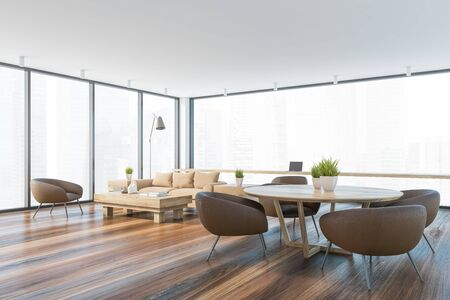 Corner of panoramic living room with beige sofa, coffee table, round dining table with brown armchairs and home office area near window with blurry cityscape. 3d rendering Фото со стока