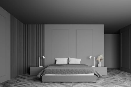 Interior of minimalistic master bedroom with gray and wooden walls, wooden floor, comfortable king size bed and two bedside tables. 3d rendering