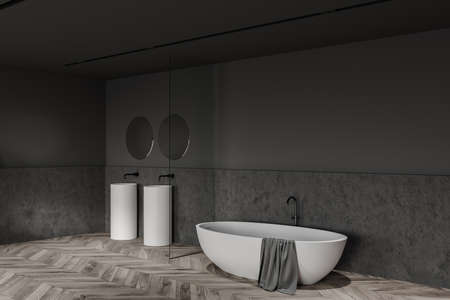 Corner of loft bathroom with dark gray and stone walls, wooden floor, cozy bathtub and double sink with two round mirrors. 3d rendering