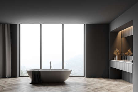 Interior of panoramic bathroom with gray and wooden walls, wooden floor, double sink with big mirror and cozy bathtub standing near window with blurry mountain view. 3d rendering