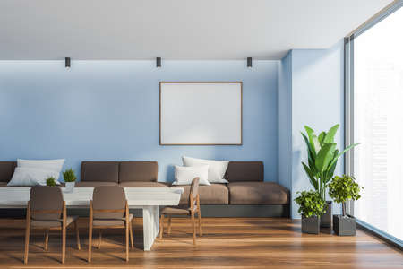Interior of stylish dining room with blue walls, wooden floor, long table with brown chairs and long sofa with white cushions. Window with blurry cityscape and horizontal mock up poster. 3d rendering