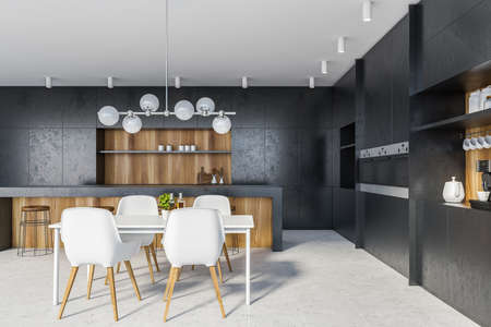 Interior of stylish kitchen with black and wooden walls, tiled floor, comfortable countertops, bar with stools and white dining table with chairs. 3d rendering Reklamní fotografie
