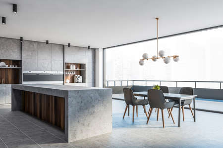 Corner of modern kitchen with stone and wooden walls, tiled floor, comfortable countertops, bar with stools, gray dining table with chairs and balcony with blurry cityscape. 3d rendering