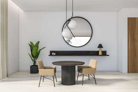 Interior of modern dining room with white walls, wooden floor, round dark wooden table with beige armchairs and round mirror. 3d rendering