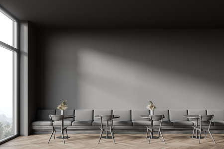 Interior of panoramic cafe with dark gray walls, wooden floor, cozy round tables with armchairs and comfortable long sofa. Window with blurry mountain view. 3d rendering Reklamní fotografie