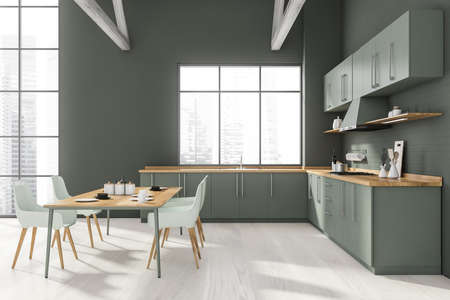 Front view of stylish kitchen with gray brick walls, wooden floor, gray countertops and dining table with white chairs. Window with blurry cityscape. 3d rendering