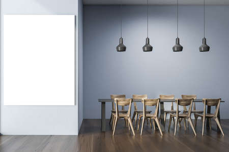 Interior of stylish office cafe with blue walls, wooden floor, gray dining table with wooden chairs and vertical mock up poster. 3d rendering