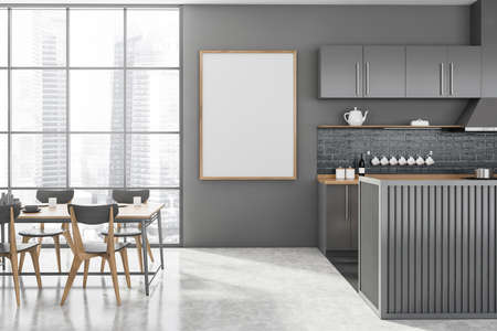 Interior of modern kitchen with gray walls, concrete floor, gray and wooden island and dining table with gray chairs standing near window with blurry cityscape. Vertical mock up poster. 3d rendering