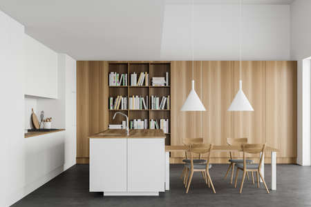 Interior of modern kitchen with white and wooden walls, concrete floor, white countertops, comfortable island, dining table and bookcase. 3d rendering Reklamní fotografie