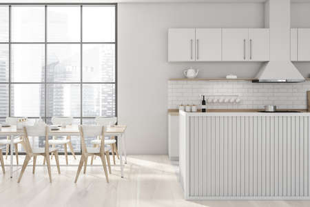 Interior of stylish kitchen with white walls, wooden floor, white and wooden island and long dining table with chairs standing near window with blurry cityscape. 3d rendering Reklamní fotografie