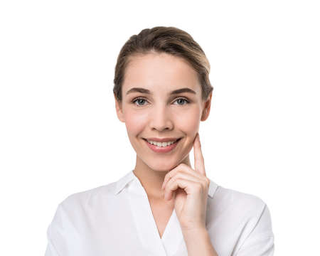 Isolated portrait of smiling young businesswoman in white shirt with fair hair. Concept of good emotions 免版税图像