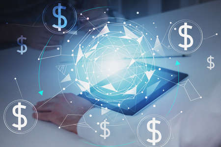Man hands with tablet at blurry office with double exposure of blockchain interface. Concept of cryptocurrency. Toned image