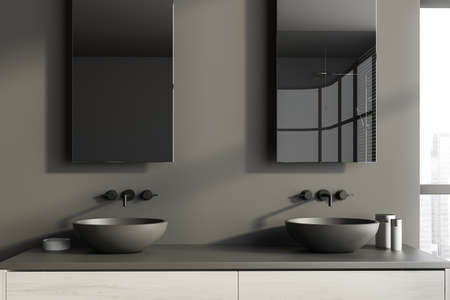 Close up of double sink standing on white countertop in modern bathroom with gray walls. 3d rendering