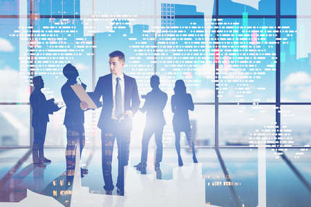 Businessman with clipboard and silhouettes of business people working together in panoramic city office. Concept of partnership and collaboration. Toned image double exposure