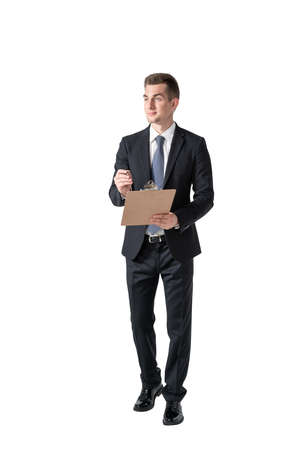 Isolated full length portrait of young European businessman with clipboard. Concept of management 免版税图像 - 153315661