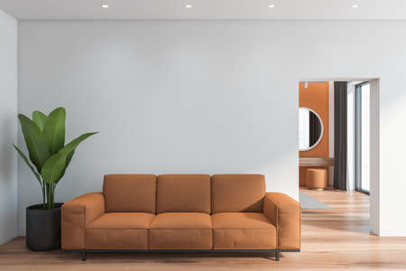 Interior of modern living room with white walls, wooden floor and comfortable brown sofa. 3d rendering