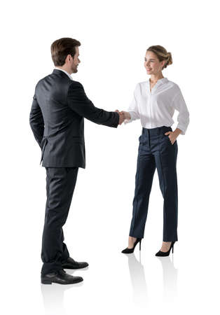 Isolated portrait of businessman and businesswoman shaking hands. Concept of partnership and management