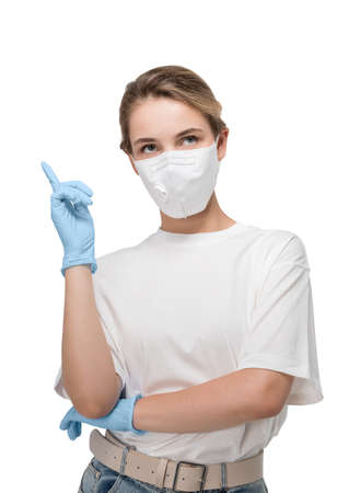 Isolated portrait of young woman in white t shirt wearing protective mask. Concept of coronavirus pandemic 免版税图像