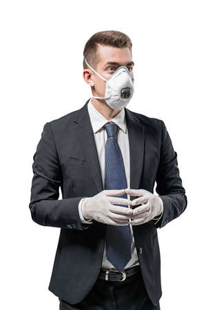 Isolated portrait of serious young European businessman in elegant suit, protective mask and rubber gloves 免版税图像 - 153315731
