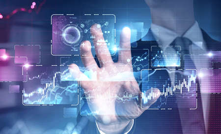 Hand of businessman using immersive infographic interface in blurry office. Concept of hi tech. Toned image double exposure. Elements of this image furnished by NASA 免版税图像 - 153315743