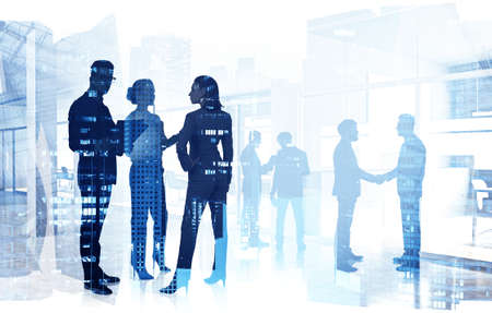 Silhouettes of business people working in blurry office with double exposure of cityscape. Toned image