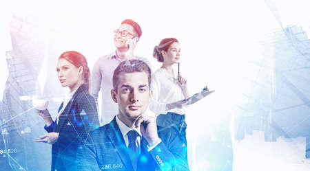 Portrait of four diverse business people working together in blurry abstract city with double exposure of digital graph. Toned image 免版税图像 - 153371740