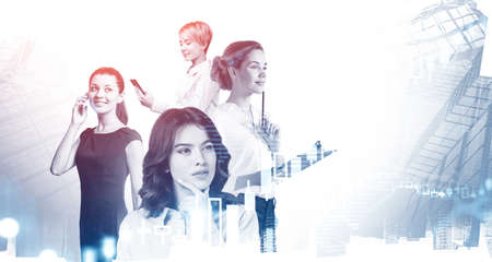 Portrait of four beautiful young businesswomen working together in blurry city with double exposure of financial graphs. Concept of teamwork. Toned image 免版税图像 - 153371746