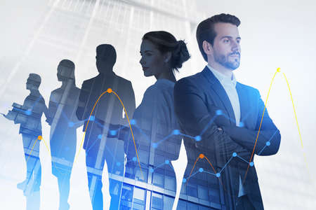 Portrait of business people standing together in city with double exposure of financial graphs. Toned image