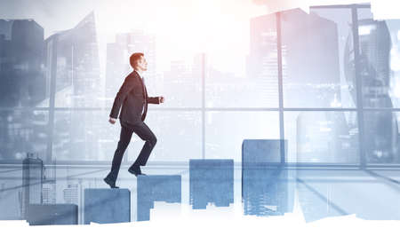 Side view of young businessman climbing growing graph in blurry office. Concept of financial success and career growth. Toned image double exposure