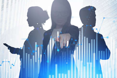 Businesswoman and her colleagues using stock market interface in blurry city. Toned image Stock fotó
