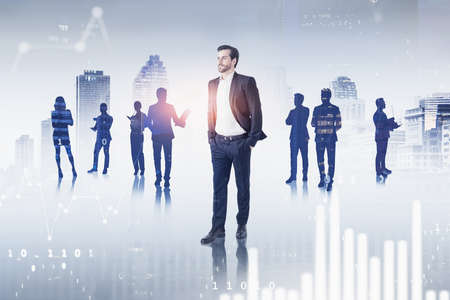 Portrait of confident young businessman and his team in blurry city with double exposure of graphs. Toned image Imagens