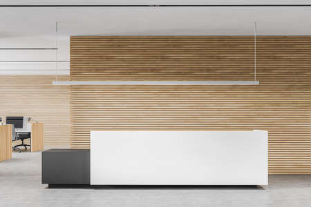 Comfortable white and gray reception counter standing in stylish office with white and wooden walls and concrete floor. 3d rendering