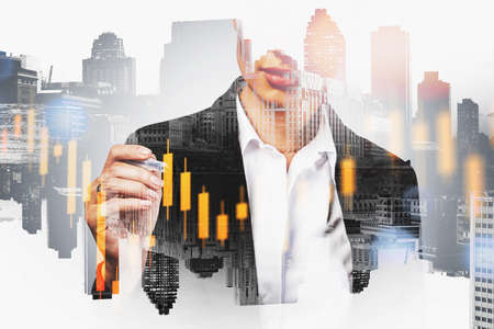 Unrecognizable young businesswoman working with digital graph in blurry city. Toned image double exposure