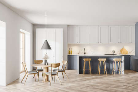 Interior of stylish kitchen with white and gray walls, wooden floor, dining table with chairs and bar. 3d rendering