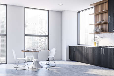 Corner of stylish kitchen with white walls, concrete floor and black cabinets with built in sink and cooker. Dining table with chairs. 3d rendering Imagens