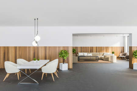 Interior of modern dining room with white and wooden walls, concrete floor, dining table with white armchairs and living room in background. 3d rendering