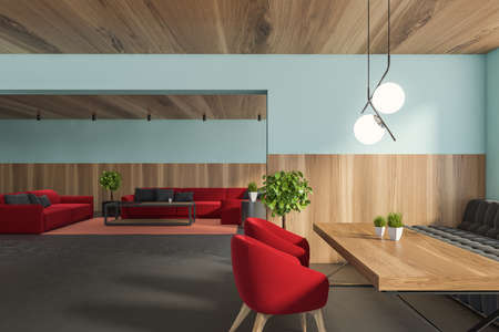 Interior of stylish dining room with blue and wooden walls, concrete floor, dining table with red armchairs and living room in background. 3d rendering
