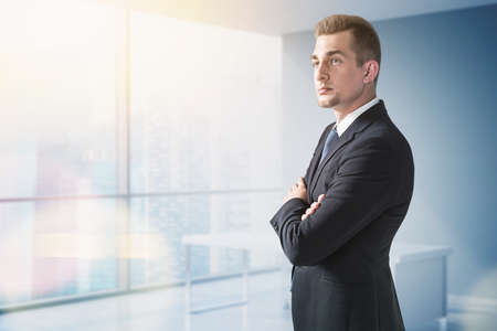 Confident businessman in suit in panoramic office Stock fotó