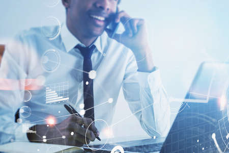 Unrecognizable smiling African American businessman talking on smartphone in blurry office with double exposure of network interface. Toned image