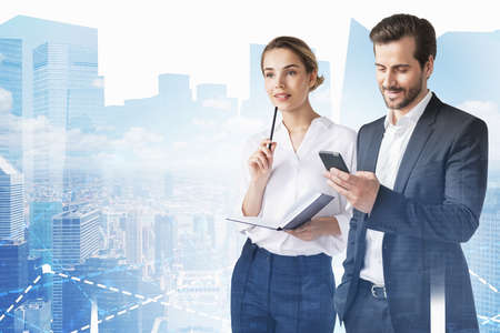Portrait of smiling young businessman with smartphone and businesswoman with planner in blurry city. Toned image double exposure
