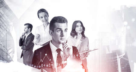 Portrait of four business people working in blurry black and white city with double exposure of graphs. Concept of teamwork. Toned image