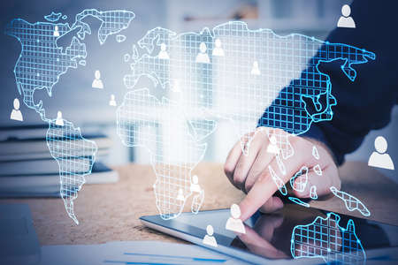Hand of businessman using tablet in blurry office with double exposure of HR interface. Toned image. Elements of this image furnished by NASA