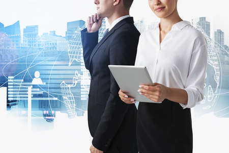 Unrecognizable businesswoman and businessman working in blurry city with double exposure of social network interface. Concept of recruitment. Toned image