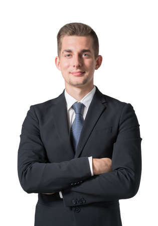 Isolated half length portrait of a young confident European businessman standing with his arms folded and looking at the viewer. Concept of leadership