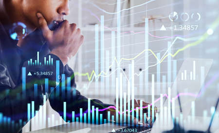 African American businessman or stock trader analyzing stock graph chart, side view stock trader using laptop to buy or sell shares, double exposure graph, internet trading concept.