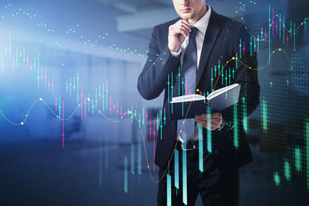 Businessman, trader checking his previous prediction about stock market behavior, forecast and business report hologram. Business and financial success concept. double exposure